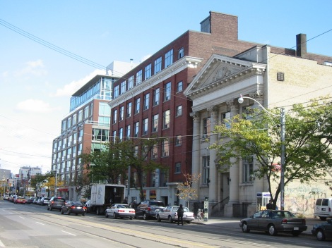 A modern mid-rise building next to a historic mid-rise building on College Street